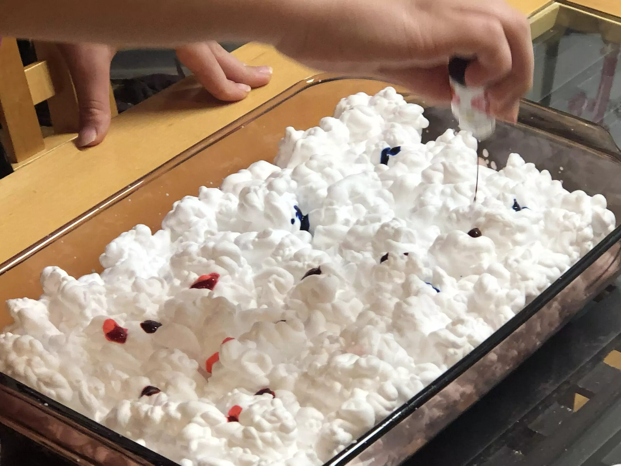 Add scattered drops of food coloring.